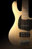 Guitare basse en bois Photos stock