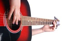Guitare dans la main de fille Photographie stock