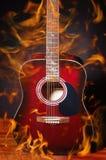 Guitare en flamme Photo libre de droits