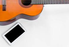 Guitare et cadre mobile des textes Photos libres de droits