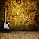 Guitare  in a grunge textile room Royalty Free Stock Photos