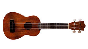 Guitare hawaïenne d'ukulele avec quatre chaînes de caractères d'isolement Images libres de droits