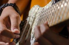 Guitare soloe, joueur de guitare photographie stock