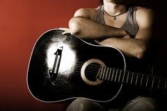 Guitare sur le rouge Photos libres de droits