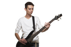 The guitarist. The young guy with a bass guitar on a white background Stock Photo
