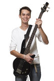 The guitarist. The young guy with a bass guitar on a white background stock images