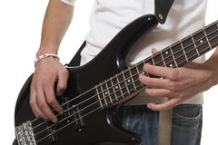 The guitarist. The young guy with a bass guitar on a white background royalty free stock images