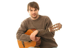 Guitarist. Portrait of professional guitarist holding his guitar isolated on white background Royalty Free Stock Photos