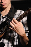 Guitarist. The guitarist plays on a guitar shooting closeup Stock Images