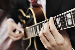 Guitarist. Jazz musician playing with electric guitar. Short depth-of-field Royalty Free Stock Image