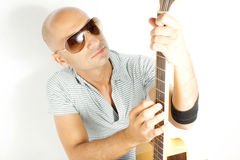 Guitarist. On a white background Stock Images