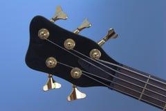 Guitarist. Closeup of guitar neck adjusting keys Royalty Free Stock Image