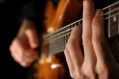 Guitarist. Man at work Royalty Free Stock Image