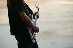 Guitarist. A guitarist performing in a concert Royalty Free Stock Photo
