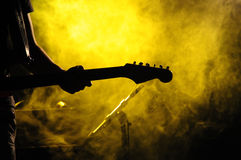 Guitarist. Hand of a guitarist playing a guitar Stock Photos