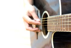 Guitarist. Young artist playing guitar on white background Stock Images