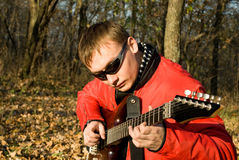 Guitarist. Plays electric guitar outdoor Royalty Free Stock Photography