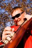Guitarist. Plays electric guitar outdoor Royalty Free Stock Photos