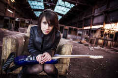 Guitarist on abandoned building Stock Photography
