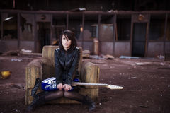 Guitarist on abandoned building stock images