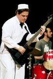 Guitarist in arabian clothes Stock Photos