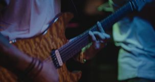 Guitarist on stage, colorful, soft focus and blur. Guitarist bass on stage for background, colorful, soft focus and blur stock video footage
