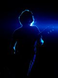 Guitarist in blue Royalty Free Stock Photography
