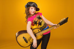 Guitarist. Child. Girl playing guitar. Stock Photo