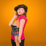 Guitarist. Child. Girl playing guitar. Stock Photos