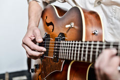 Guitarist. Close-up on the fingers of the guitarist Stock Photos