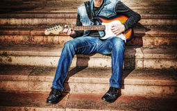 Guitarist with a colorful guitar in hdr Royalty Free Stock Image