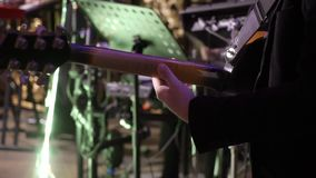 Guitarist at concert. Playing guitar in band stock footage