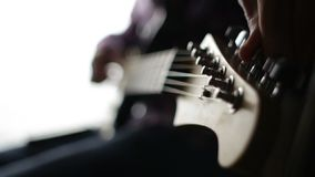 Guitarist configures electro guitar before the concert. Black white stock video