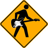 Guitarist Crossing Sign. A yellow road crossing sign with a musician with a guitar Royalty Free Stock Photo