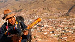 Guitarist in Cusco. Guitarist playing in the hills in Cusco royalty free stock images