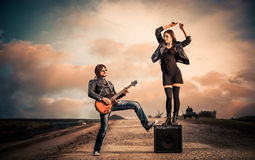 Guitarist and dancer Stock Images
