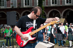 Guitarist during the demonstration for peace Royalty Free Stock Images