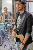 Guitarist and drummer in studio Stock Photos