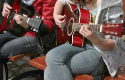 Guitarist duet. Two young girls playing acoustic guitar, real situation picture Stock Photos