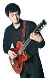Guitarist electric guitar playing isolated. Royalty Free Stock Photos
