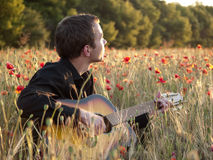 Guitarist in field Stock Photography