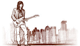 Guitarist on grunge background Stock Image