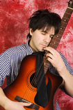 Guitarist with guitar Stock Images