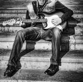 Guitarist with a guitar in black and white Stock Photo