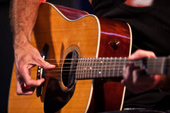 Guitarist hand with an classical guitar. Old guitarist com back to stage Royalty Free Stock Images