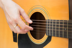 Guitarist Hand Playing Acoustic Guitar Royalty Free Stock Photo