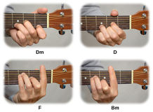 Guitarist hand playing guitar chords: Dm, D, F, Bm Stock Photos