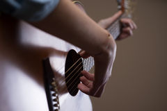 Guitarist hands close up Stock Images