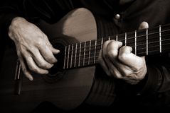 Guitarist hands and guitar royalty free stock photography