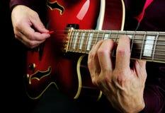 Guitarist hands and guitar. Close up Stock Photo